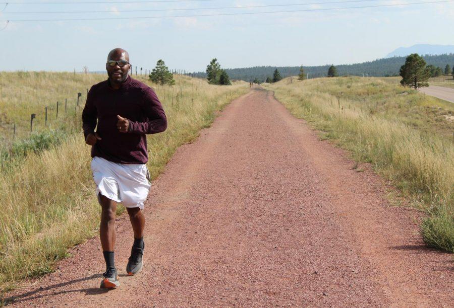 Monument resident Will Taylor runs along the New Santa Fe Regional Trail.