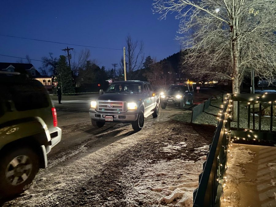 Cars line up to receive the Chili Dinner at Palmer Lake Firehouse