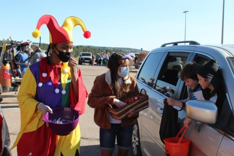 Amaya Taylor (10, left) and Diya Suri (10, right) hand out candy to kids at the Trunk-or-Treat.