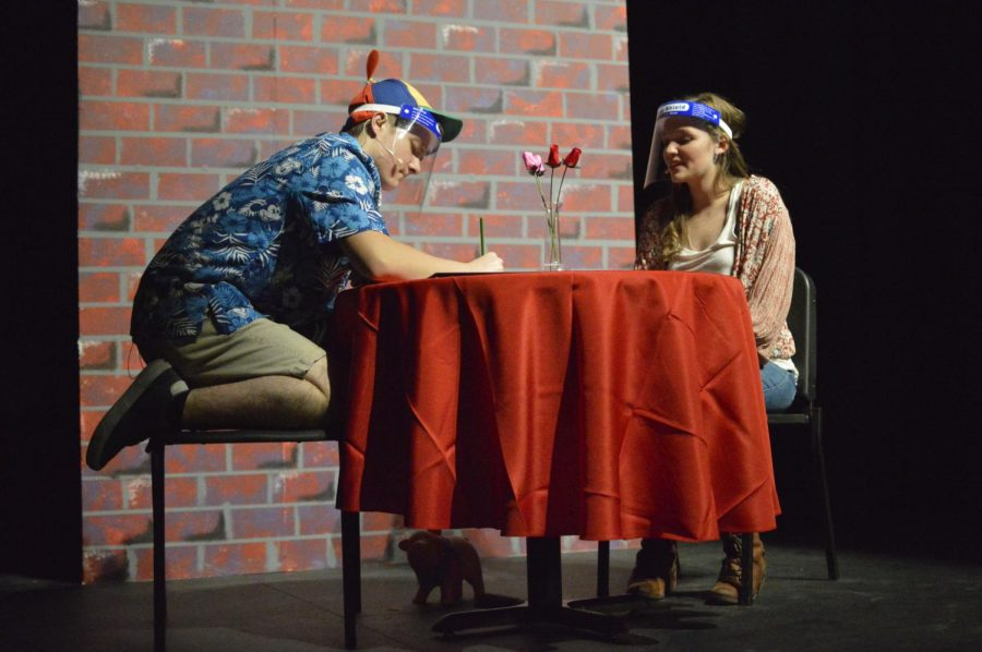 From left to right: Mason Huddleson (11) and Riley Burton (10) enact their characters in a hilariously problematic blind date.