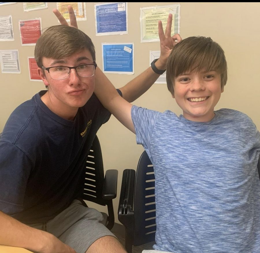 Ethan Michon (12) and his mentee, Daniel Wentworth (9) pose for a picture at PRSMs first meeting of the school year.