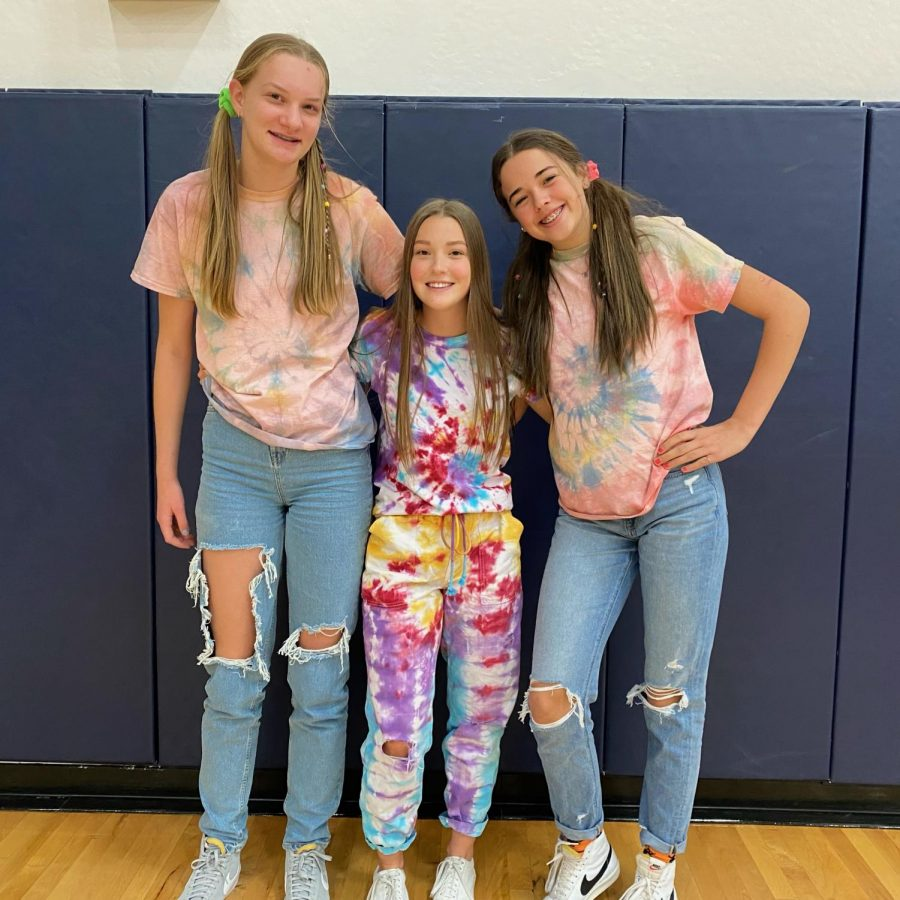 Corrie Anderson, Emily Klahn and Lacie Cook show off their tie dye outfits.