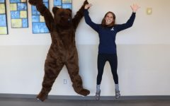 Our very own Hannah Miller (11) jumps around with the school mascot.